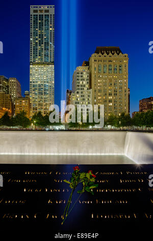 911 Tribute In Lights Memorial from Ground Zero with reflecting pool and the  beams of lights shinning high into - Stock Photo
