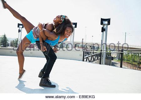 Teenage couple playing outdoors - Stock Photo