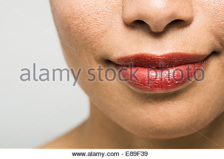 Close up portrait of woman with red lipstick - Stock Photo
