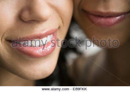 Close up portrait of smiling young women - Stock Photo