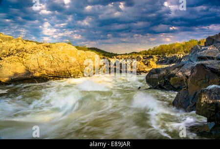 Evening light on rocks and rapids in the Potomac River, at Great Falls Park, Virginia. - Stock Photo