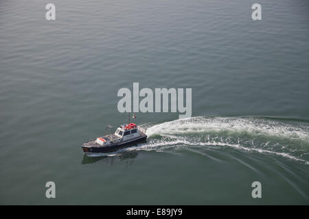 The Pilot boat of the Venice lagoon guides ships, safely into Venice every day,and is on its,way to another ship. - Stock Photo