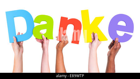 Multiethnic Group of Hands Holding Danke - Stock Photo