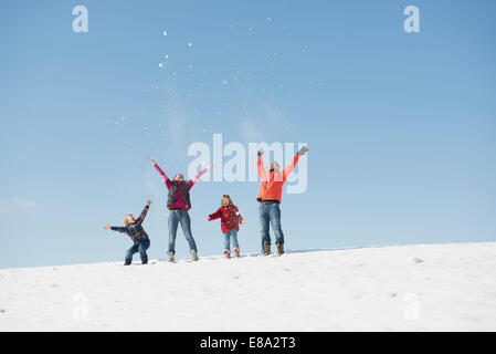 Family playing with snow in winter, Bavaria, Germany - Stock Photo