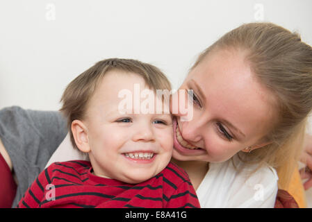 Sister and brother smiling - Stock Photo