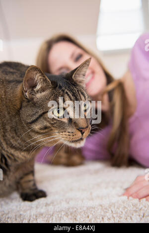 Cat and mature woman at home - Stock Photo