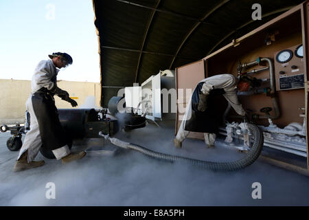 From left, U.S. Air Force Staff Sgt. Taj Copeland, a fuels distribution supervisor with the 455th Expeditionary - Stock Photo