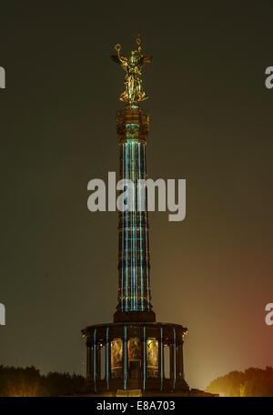 Berlin, Germany. 2nd Oct, 2014. The Siegessaeule (Victory Column) beams color for the start of the light festival - Stock Photo