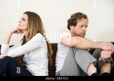 Quarreling couple in living room - Stock Photo