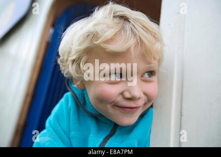 Close up portrait of young cheeky blonde boy - Stock Photo