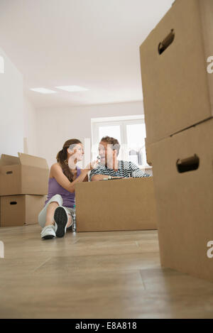 Couple eating Sushi lunch new home boxes - Stock Photo