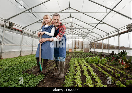 Father and daughter in greenhouse - Stock Photo