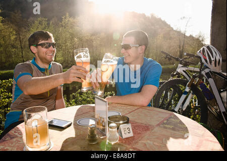 Young men drinking beer, Bavaria, Germany - Stock Photo