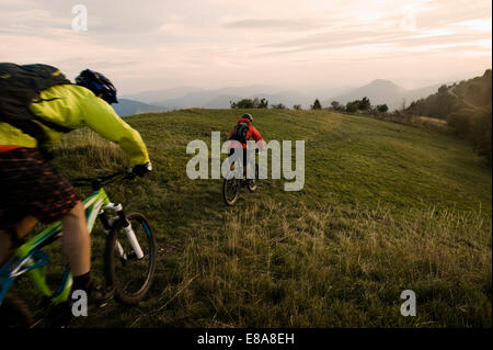 two mountain bikers on the way, Kolovrat, Istria, Slovenia - Stock Photo