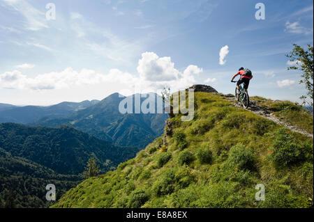 mountain biker on the way uphill, Slatnik, Istria, Slovenia - Stock Photo