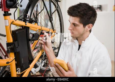 Mechanic testing electric system - Stock Photo