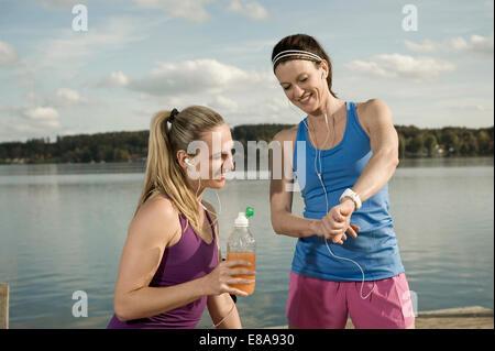 Jogging women taking a break, Woerthsee, Bavaria, Germany - Stock Photo