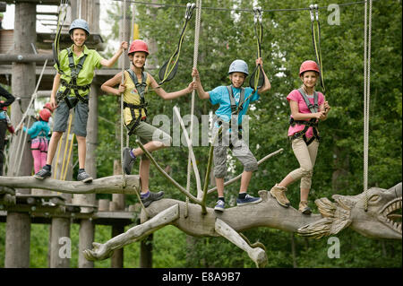 Childrens climbing on crag - Stock Photo