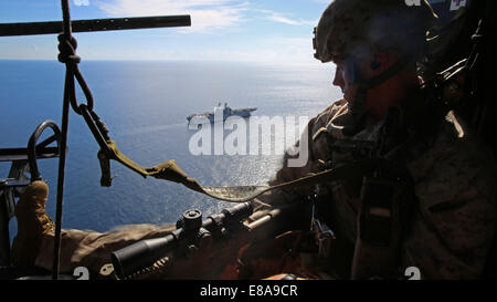 U.S. Marine Corps Cpl. Phillip Lilly II, a chief scout with Scout Sniper Platoon, Battalion Landing Team, 3rd Battalion, - Stock Photo