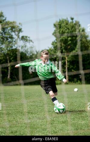 Young boy soccer penalty practice football ball - Stock Photo