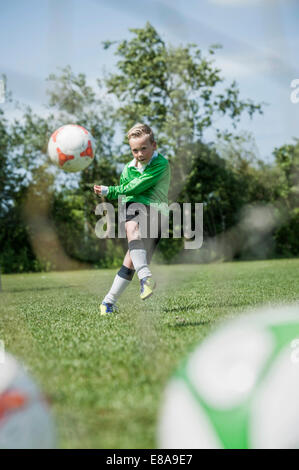 Young junior boy soccer player practicing penalty - Stock Photo