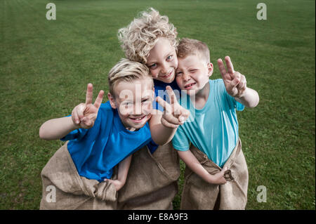 Three young blond boys posing in Sackrace - Stock Photo