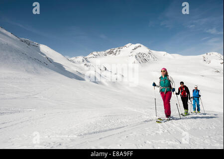 Cross-country skiing group three people snow - Stock Photo