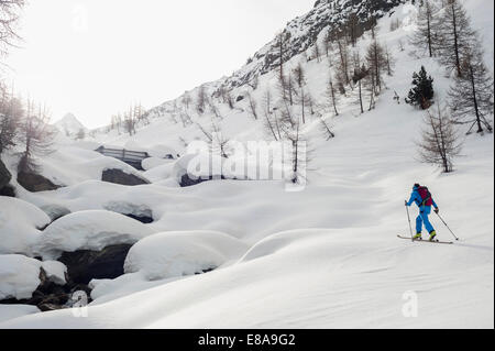 Winter landscape man skiing cross-country - Stock Photo