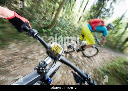 Two Mountainbikers racing down mountain track - Stock Photo
