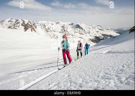 Mountain skiing group three people snow - Stock Photo