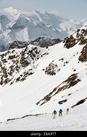 Alps mountains skiers cross-country winter - Stock Photo