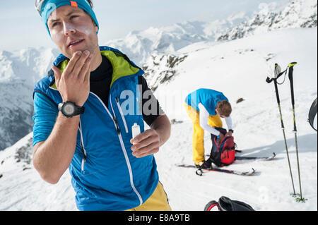 Two men Alps mountains ski tour winter - Stock Photo