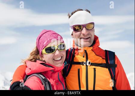 Portrait couple in winter ski suit goggle smiling - Stock Photo