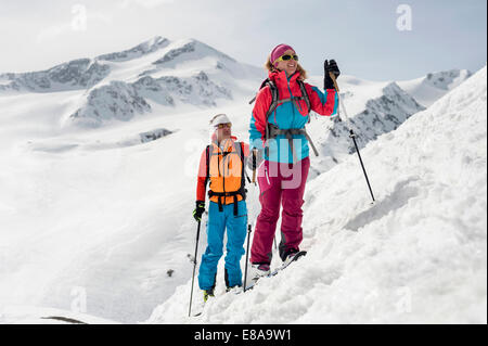 Man woman couple cross-country skiing Alps - Stock Photo
