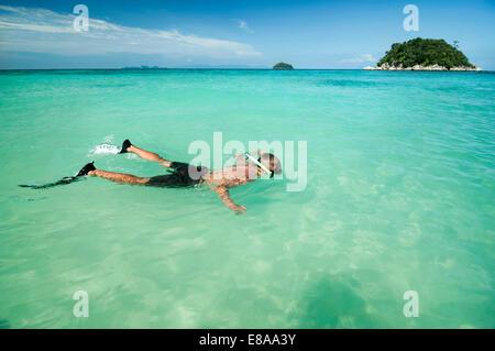 teenage boy snorkeling, Koh Lipe, Thailand - Stock Photo