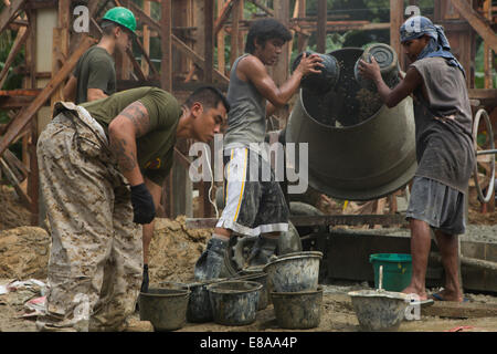 U.S. Marine Corps Staff Sgt. John Suyat, with Utilities Platoon, Engineer Company, Marine Wing Support Squadron - Stock Photo