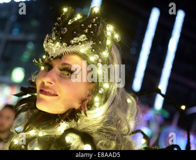 Berlin, Germany. 2nd Oct, 2014. A woman made up in lights in front of the main train station in Berlin, Germany, - Stock Photo