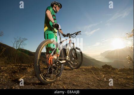 Man biking on electric mountain bike, Trentino, Italy - Stock Photo