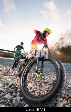 Man mountain biking in Isar footplains, Munich, Germany - Stock Photo