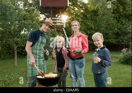 Mother father boys barbecue parents garden - Stock Photo