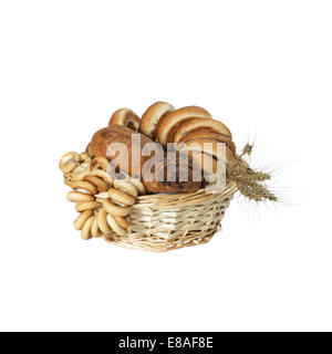Pastries and bagels with cereal ears in basket isolated on white background - Stock Photo