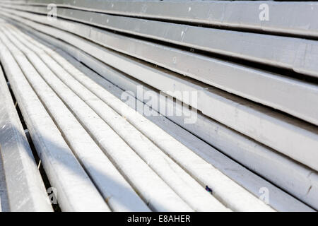 Closeup on long wooden bench - Stock Photo