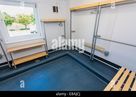 Empty clothing drying room in army barracks. - Stock Photo
