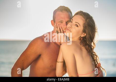 Portrait of romantic young couple at beach, Castiadas, Sardinia, Italy - Stock Photo