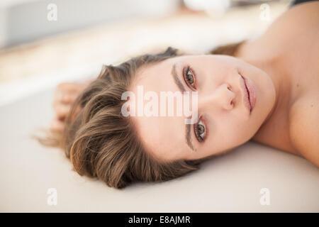 Close up portrait of young woman sunbathing, Castiadas, Sardinia, Italy - Stock Photo