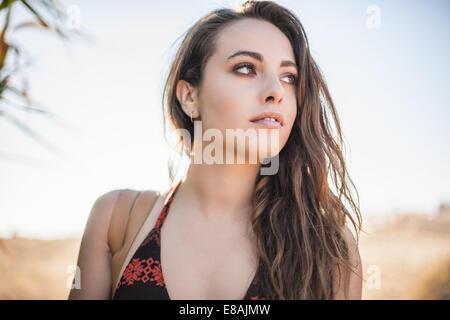 Beautiful young woman at beach, Castiadas, Sardinia, Italy - Stock Photo