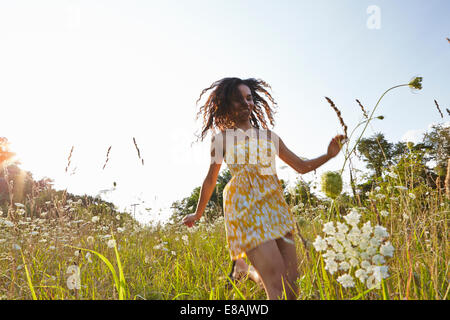 Woman in field of wildflowers - Stock Photo