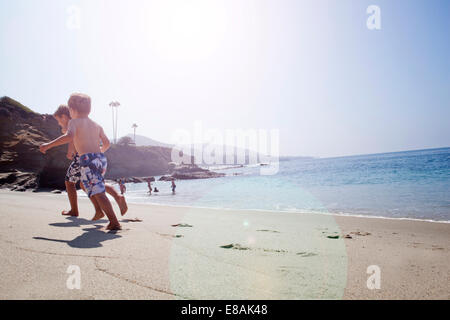 Brothers playing on beach, Laguna Beach, California, US - Stock Photo