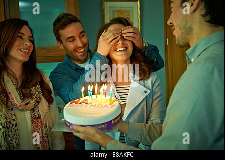 Friends celebrating birthday at home - Stock Photo