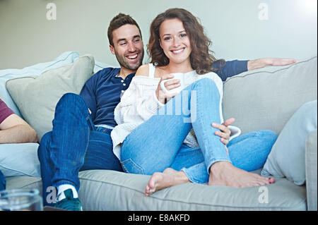 Couple chilling on sofa